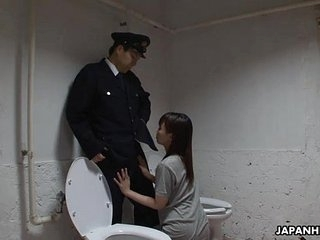 Asian locked up sucking stay away from the guard's penis