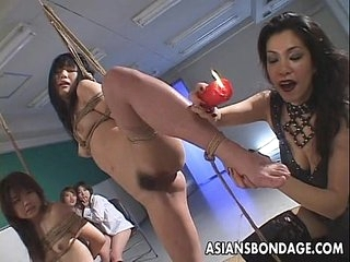 Smutty Japanese babes indulge in devise BDSM action