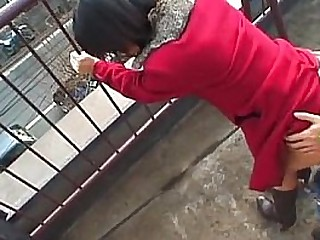 Lovely Japanese babe sucks a fast dick outdoors