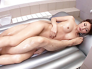Japanese babe Riri Fuji gets her body oiled up in massage sex
